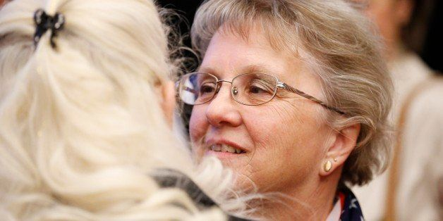 Arizona Republican candidate for State Superintendent Diane Douglas, right, talks with a supporter at the Republican election