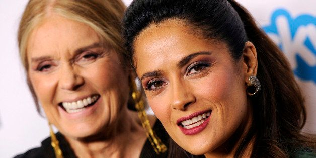 """Honorees Gloria Steinem, left, and Salma Hayek Pinault pose together at the """"Make Equality Reality"""" event at the Montage Hote"""