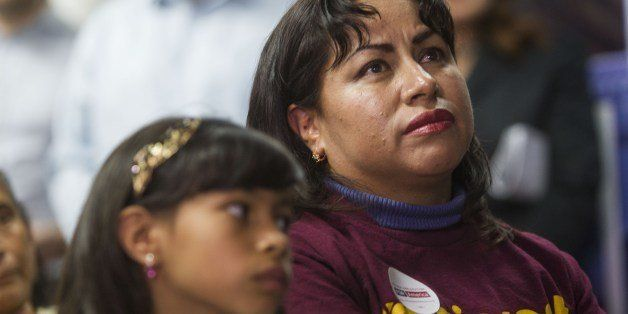 Nancy Catano, 41, a non-US citizen, with her daughter Michelle, 9, watch November 20, 2014  in Los Angeles, California,  watc