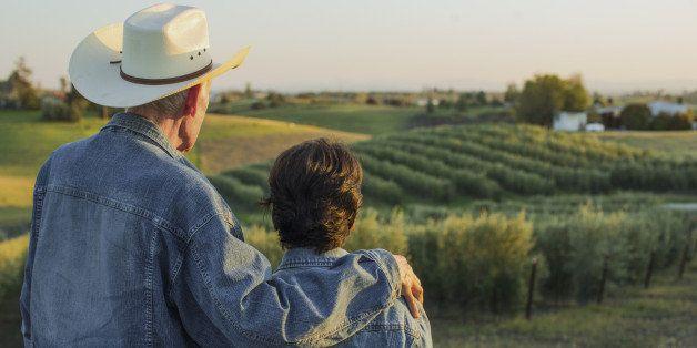 Hispanic farmers standing in vineyard