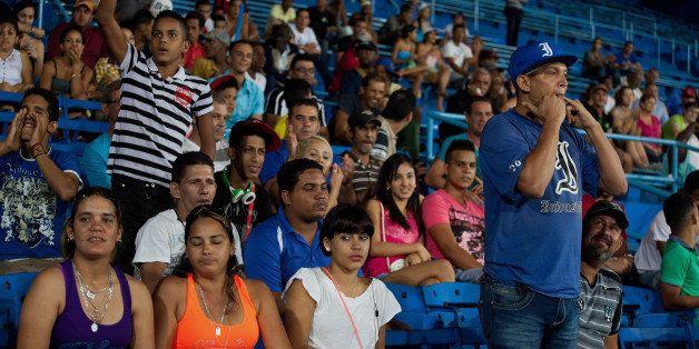Fans cheer during an Industriales baseball game at El Latinoamericano stadium in Havana, Cuba, on Wednesday, Jan. 21, 2015. C