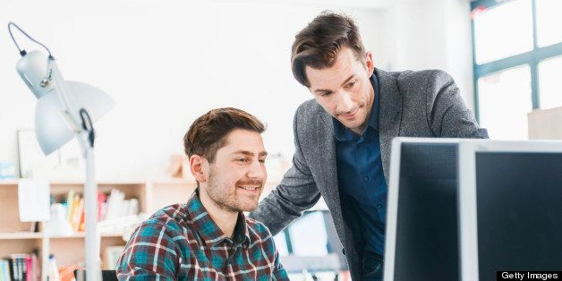 Two young people working together at a startup or small business.
