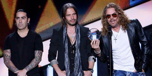 Mana receives the Billboard Spirit of Hope Award at the Latin Billboard Awards in Coral Gables, Fla., Thursday April 25, 2013