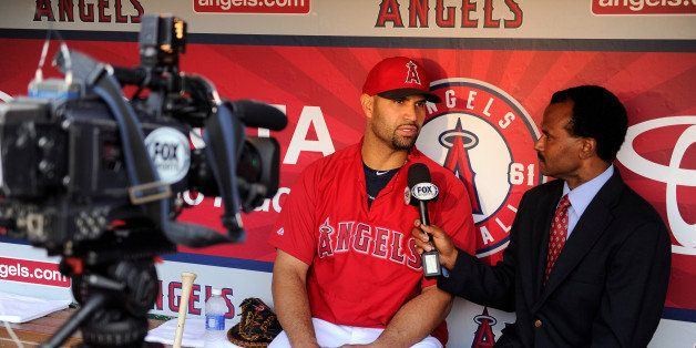 ANAHEIM, CA - JUNE 7: Albert Pujols #5 of the Los Angeles Angels of Anaheim speaks to media member Jose Mota before the game