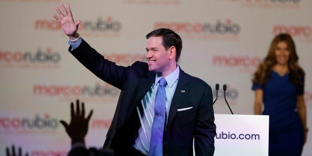 Florida Sen. Marco Rubio waves to supporters as his wife Jeanette joins him on stage, after he announced that he will be runn