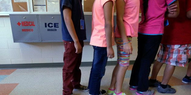Detained immigrant children line up in the cafeteria at the  Karnes County Residential Center,  a temporary home for immigran