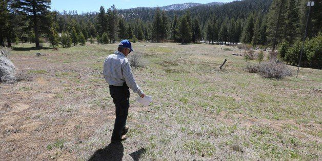 Frank Gehrke, chief of the California Cooperative Snow Surveys for the Department of Water Resources, walk out to the meadow