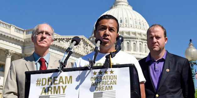 DREAM Action Coalition Co-Director Cesar Vargas, joined by Rep. Bill Foster, D-Ill.,  left, and Rep. Jared Polis, D-Colo., ri