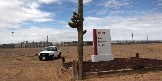 ELOY, AZ - JULY 30: A cactus and sign mark the entrance to the Eloy Detention Facility for illegal immigrants on July 30, 201