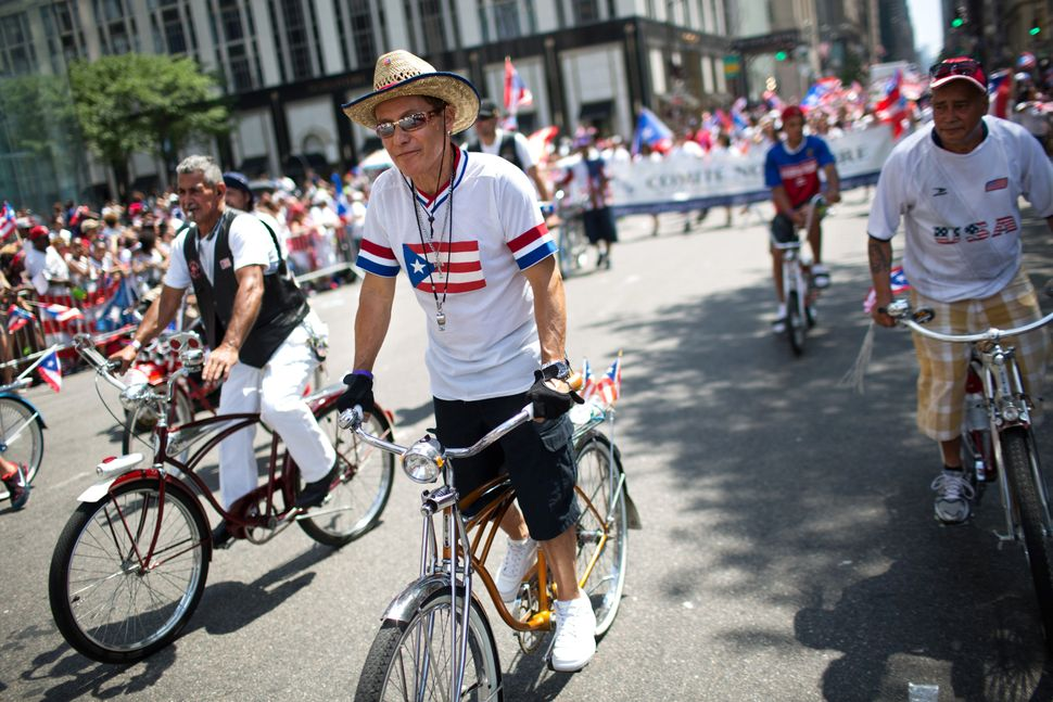 Members of the Puerto Rican Schwinn club ride in the annual National Puerto Rican Day Parade as it makes its way up New York'