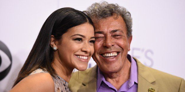 Gina Rodriguez, and Genaro Rodriguez pose in the press room at the People's Choice Awards at the Nokia Theatre on Wednesday,