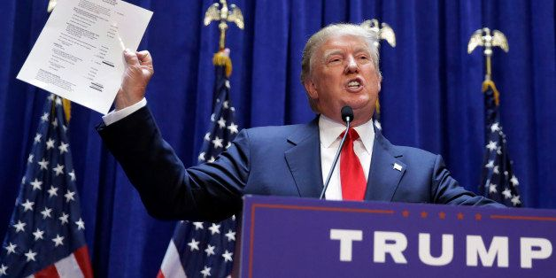 Developer Donald Trump displays a copy of his net worth during his announcement that he will seek the Republican nomination f
