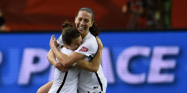 MONTREAL, QC - JUNE 30:  Kelley O'Hara and Lauren Holiday of the United States celebrate after the FIFA Women's World Cup 201