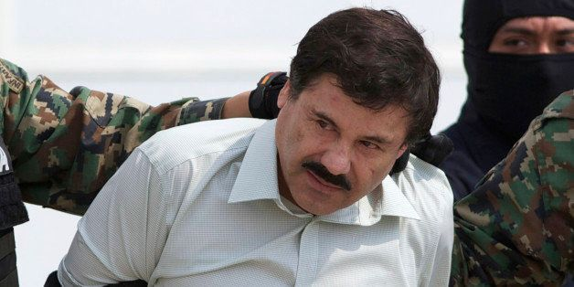 """FILE - In this Feb. 22, 2014 file photo, Joaquin """"El Chapo"""" Guzman, head of Mexico's Sinaloa Cartel, is escorted to a helic"""