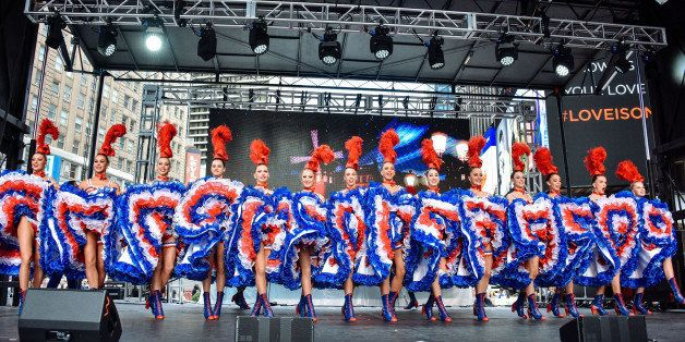 NEW YORK, NY - SEPTEMBER 27:  Moulin Rouge dancers perform at the Best Of France main stage in Times Square on September 27,