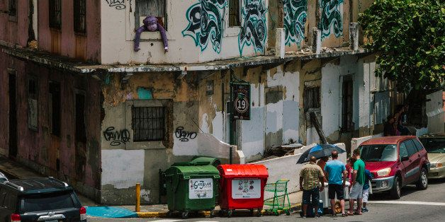 Graffiti is seen on the walls of a building in the Old City of San Juan, Puerto Rico, on Wednesday, July 8, 2015. A growing n