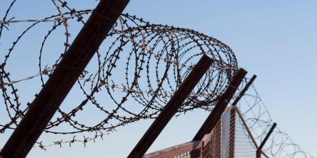 Security with a barbed wire fence photo. Protection concept design.