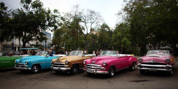 HAVANA, CUBA - SEPTEMBER 16:  Vintage American cars being used as tourist taxis are parked alongside each other as drivers wa