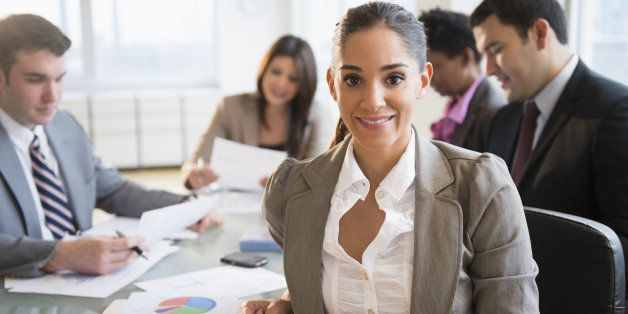 Businesswoman smiling in meeting