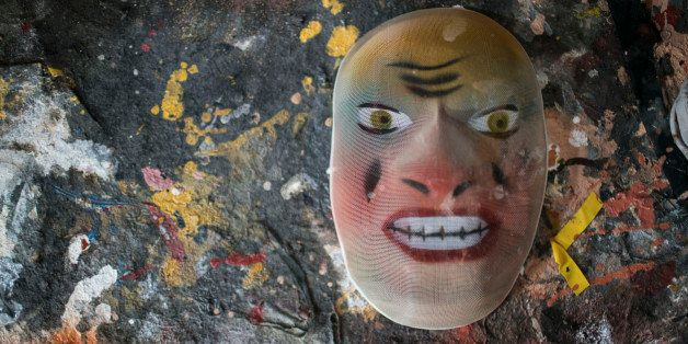 A carnival mask sits on a table at the Condal mask factory, well known for its clever designs featuring politicians or other