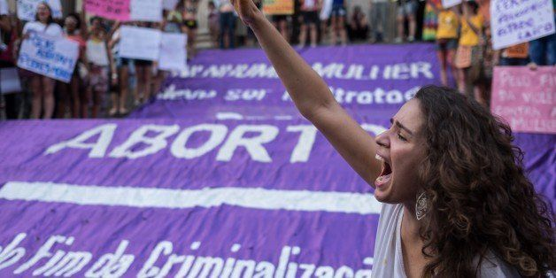 Brazilian women demonstrate in favor of abort legalization and against the president of the Brazilian Chamber of Deputies, Ed