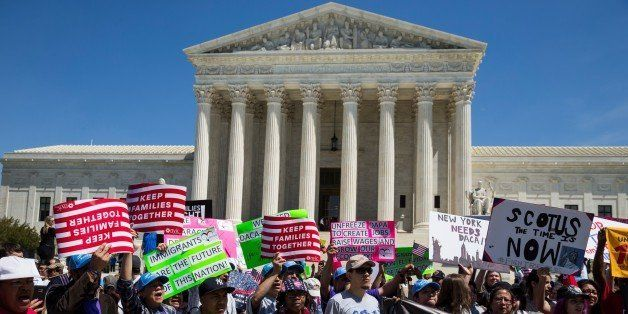 WASHINGTON, USA - APRIL 18: Pro-immigration supporters gather outside of the Supreme Court which was hearing arguments of Pre