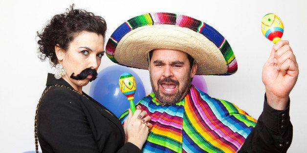 Studio Shot of two people dressed up as Mexicans
