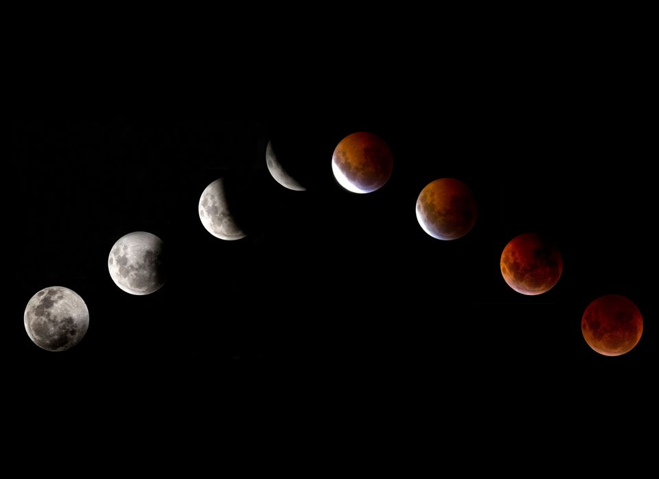 This combination of pictures shows the moon in various stages of a total lunar eclipse as seen from Mexico city on December 2