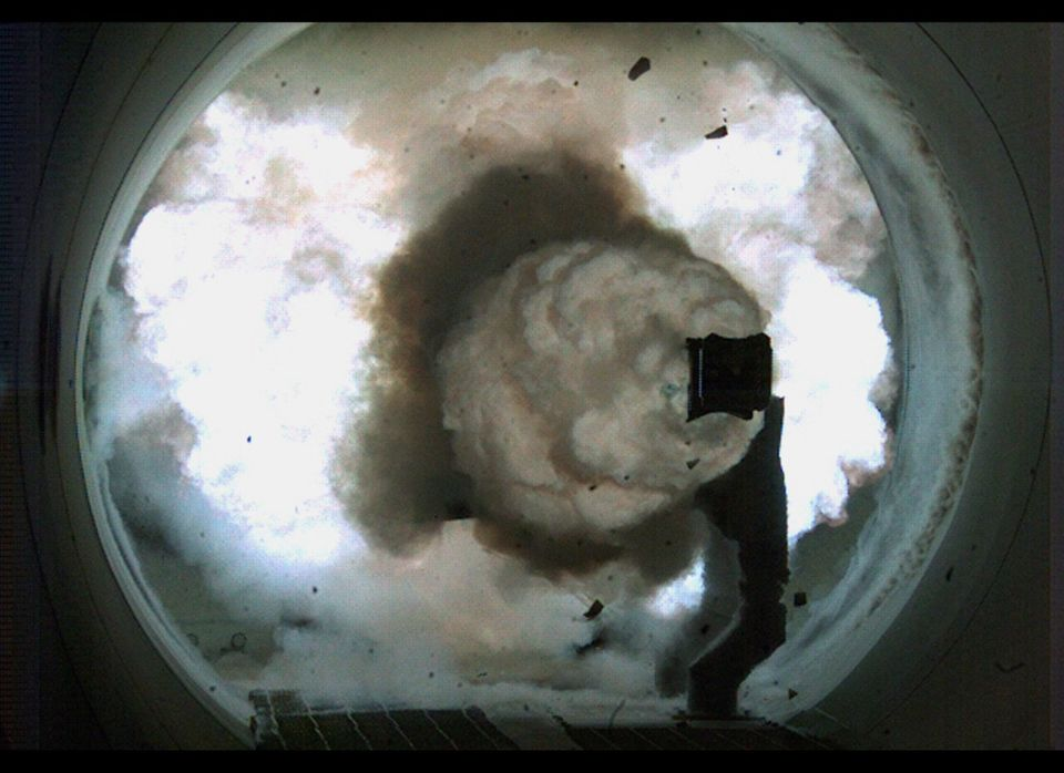 This image released by the US Navy shows a high-speed camera image of the Office of Naval Research's Electromagnetic Railgun