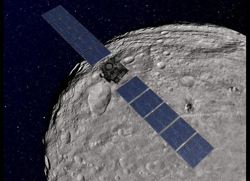 This artist's concept shows NASA's Dawn spacecraft orbiting the giant asteroid Vesta. The depiction of Vesta is based on imag
