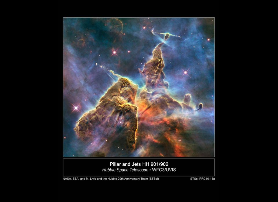 Hubble's 20th anniversary image shows a mountain of dust and gas rising in the Carina Nebula. The top of a three-light-year t