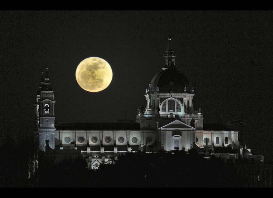 A perigee moon rises above the Almudena Cathedral in Madrid on March 19, 2011. A perigee moon is visible when the moon's orbi