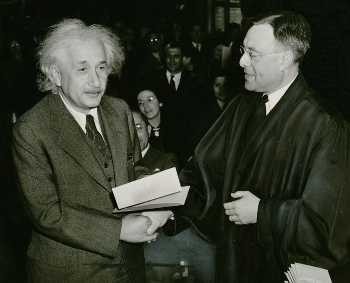 Photograph shows Albert Einstein receiving from Judge Phillip Forman his certificate of American citizenship. |  Source Libra