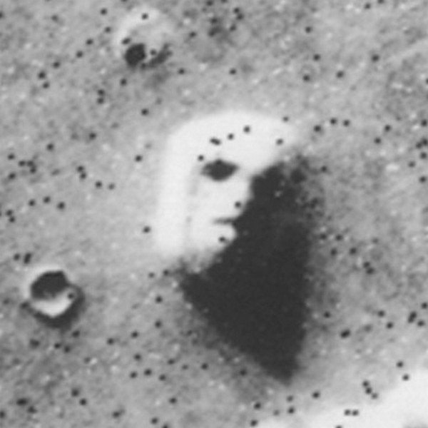 "Taken in 1976 by the Viking 1 probe, this photo caused a stir until later, higher-resolution photos showed that the ""face"" wa"