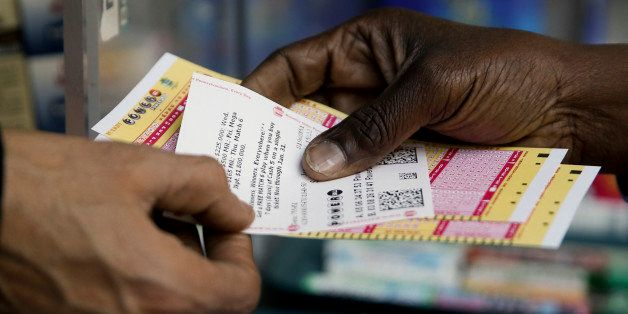A person purchase Powerball lottery tickets from a newsstand Wednesday, Jan. 6, 2016, in Philadelphia. Players will have a ch