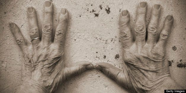 Senior Woman Hands on the wall (sepia toned)