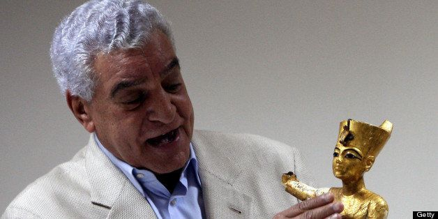 Egyptian State Minister of antiquities Zahi Hawass holds a golden statuette of King Tutankhamun during a news conference in C