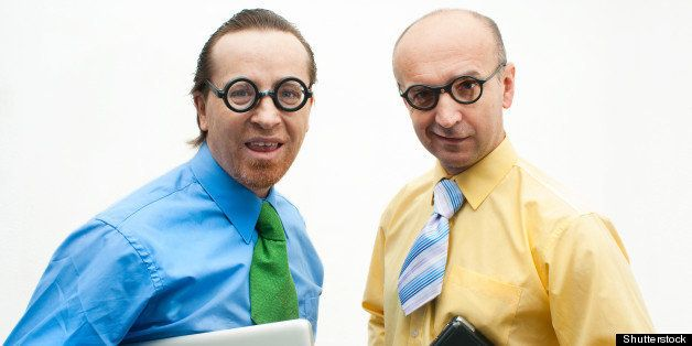 Two crazy businessman with laptops