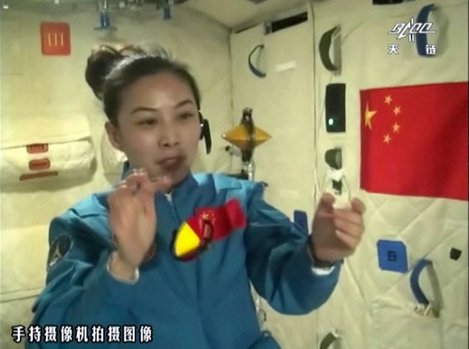 In this image taken June 20, 2013 and made from CCTV, Chinese female astronaut Wang Yaping shows motion behavior of two spinn