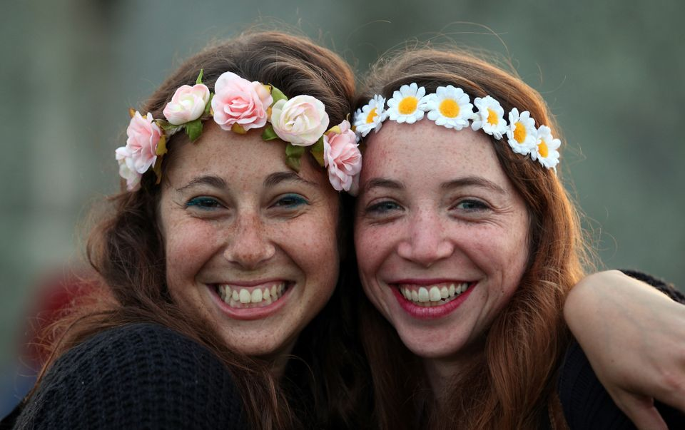 AMESBURY, ENGLAND - JUNE 20:  Jessica Matla and Mica Sviddo pose for a photograph as they wait for the arrival of the midsumm