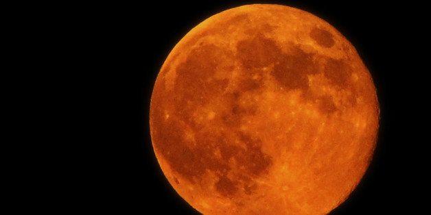 Harvest moon at dark night.