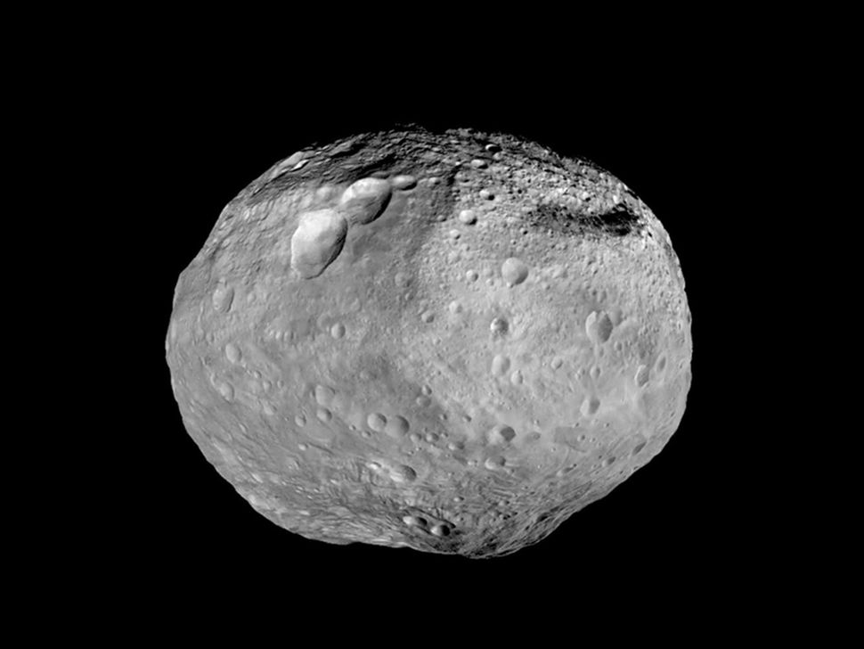 NASA's Dawn spacecraft provided views of the massive asteroid Vesta. The mountain on the asteroid's south pole is more than t