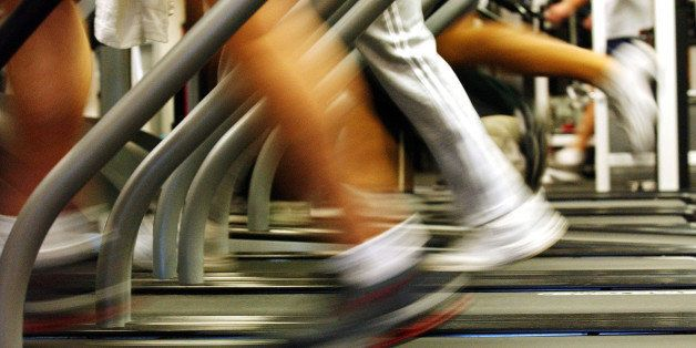 BROOKLYN, NEW YORK - JANUARY 2:  People run on treadmills at a New York Sports Club January 2, 2003 in Brooklyn, New York. Th