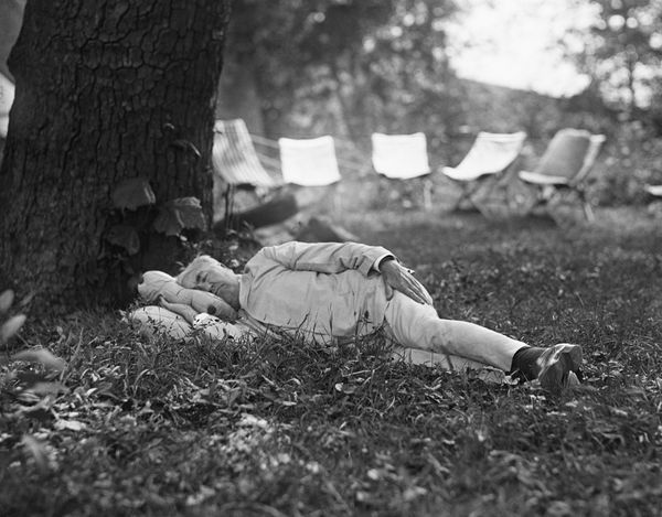 Thomas Edison (1847-1931) taking a nap while on a camping trip with President Harding in 1921.