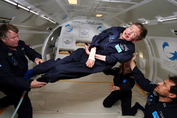 Astrophysicist Stephen Hawking (born 1942) goes weightless on a zero-G flight.