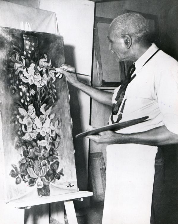 American scientist and educator George Washington Carver (1864-1943), working on one of his last paintings, entitled 'The Yuc