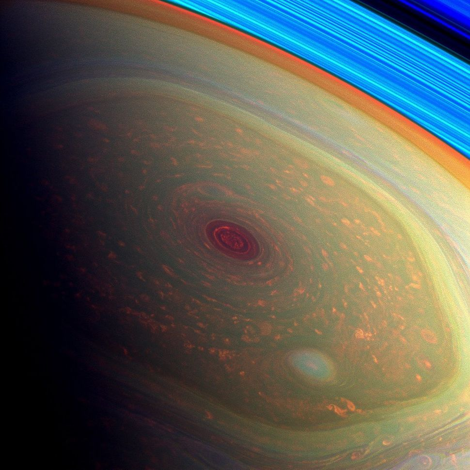 This vertigo-inducing, false-color image from NASA's Cassini mission highlights the storms at Saturn's north pole. The angry