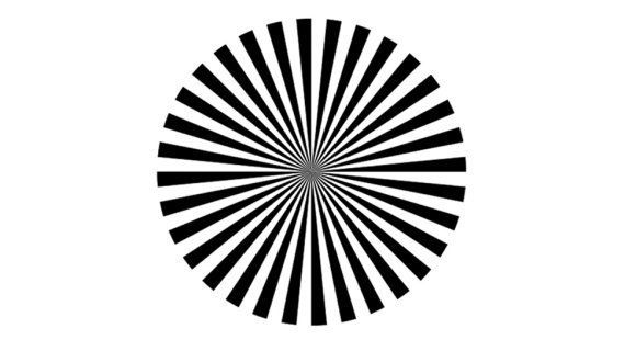 Stare at the pinwheel for a few seconds then look at a spot slightly away from it. You should be able to see the centre of th
