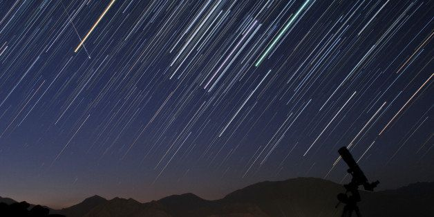 UNSPECIFIED - SEPTEMBER 07:  A bright meteor during Perseid meteor shower (Aug. 12) is captured in a star trail image of cons