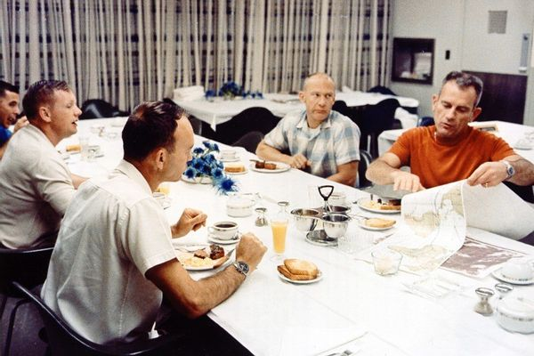 "The Apollo 11 crew and Donald K. ""Deke"" Slayton at the traditional launch day steak and eggs breakfast."